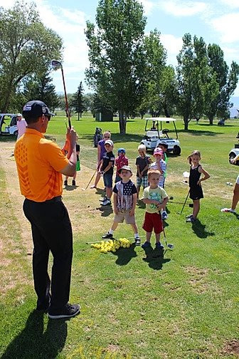 juniors being instructed how to golf
